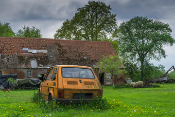 Old small car on a poor village