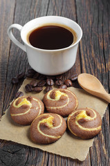 Tasty cookies with coffee