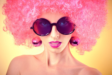 Glamorous sexy girl in fashionable glasses with afro hairstyle