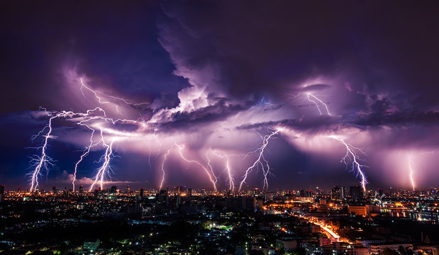 Lightning storm over city in purple light