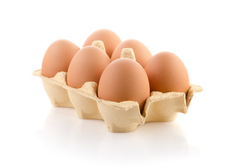 Six brown eggs in carton on white with clipping path
