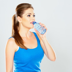 fitness woman drink water . isolated.