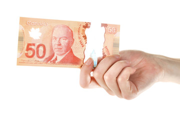 Female hand with Canadian 50 Dollar, isolated on white