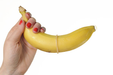 condom banana in hands for safe sex
