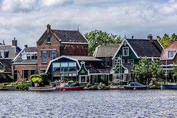 Dutch rural scenery: small village on river shore in Zaandam.