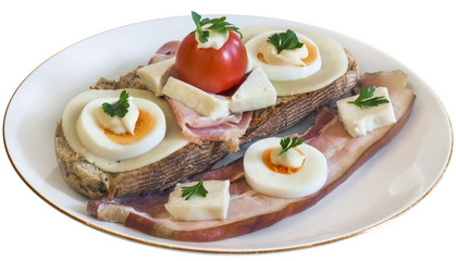 Bacon Cheese Egg Ham and Tomato Sandwich on Plate Isolated.
