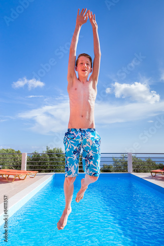 Young teen boy naked at pool