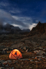 Tourist camping at night in the mountains