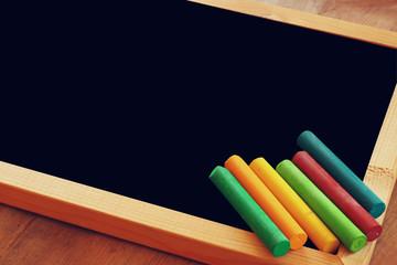 old vintage wooden blackboard on wooden table