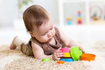 baby girl playing with toys indoor