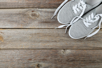 Pair of grey shoes on wooden background Wall mural