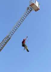 firefighters hung the rope climbing durinf fire drill