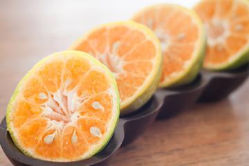 Keuken foto achterwand Plakjes fruit Slice of fresh orange in wooden tray
