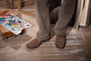 Man's Legs And Palette With Dyes