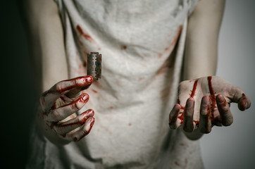 a man holding a bloody razor for suicide in the studio
