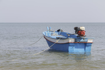 Small blue boat on the sea