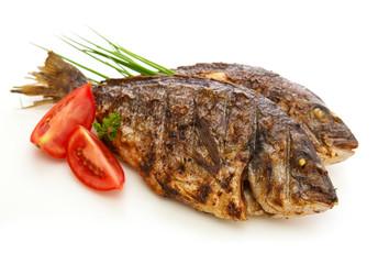 Two roasted dorade fish  isolated.