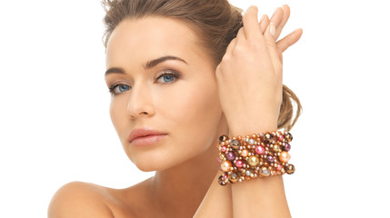 woman wearing bracelet with beads