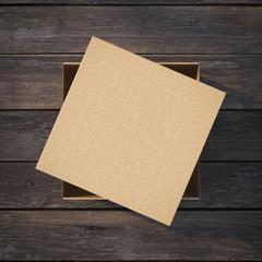 Cardboard box with a cap
