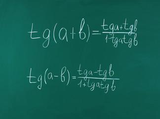 Math formulas on blackboard background