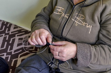 Woman work with knitting-needle in home