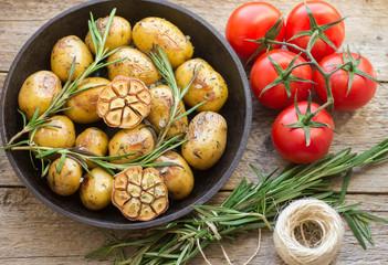Small baked potato with rosemary  and  garlic