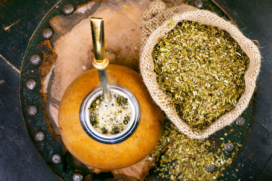 Yerba mate in a traditional gourd and bag of dry herb
