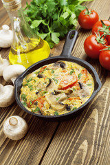 Omelet with mushrooms and tomatoes. Frittata