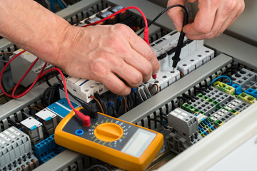 Electrician Checking Fuse