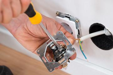 Technician Fixing Socket