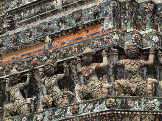 Demon Guardian statues decorating the Buddhist temple, Thailand