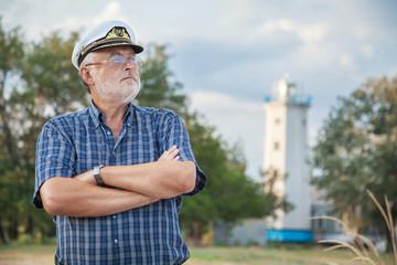 Elderly captain on the sea shore