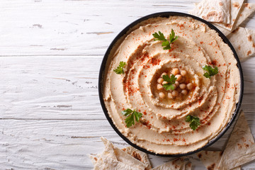 Classic hummus and pita bread. horizontal top view