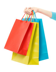Woman hand holding shopping bags on white, clipping path