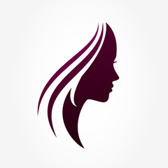 Beautiful woman's profile face with streaming hair. Vector logo