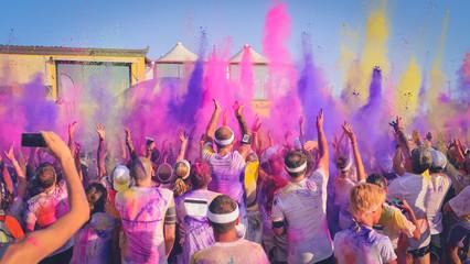 Celebrants dancing during the color Festival