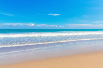 Tropical beach and beautiful sea. Blue sky with clouds in the ba