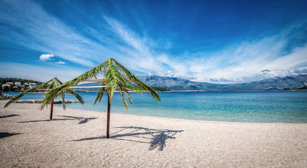 Printed kitchen splashbacks Zanzibar Palm umbrellas on beach in Croatia