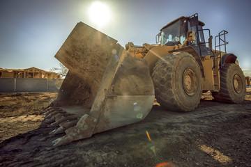 Construction site digger bulldozer