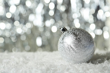 Christmas ball on lights background
