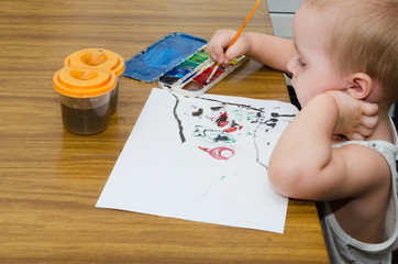boy drawing the picture