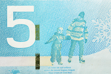 Close up of 5 Canadian dollars