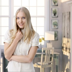 Attractive casual young blonde woman at retro home