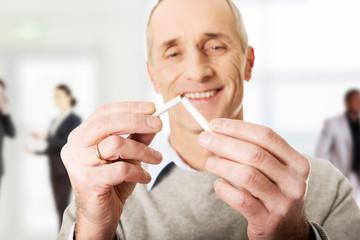 Successful man with broken cigarette