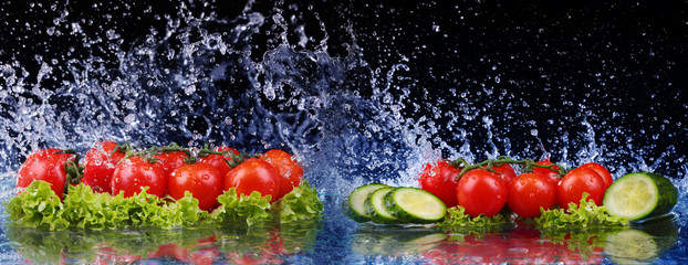 Salad, tomato and with water drop splash