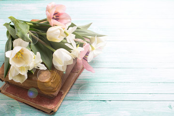 Background with fresh flowers and  old books