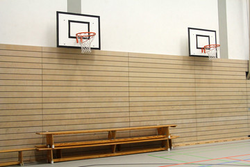 Wooden benches and basketball baskets in the gym