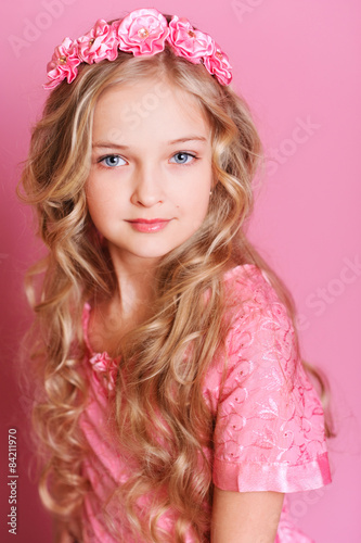 """""""Cute Kid Girl 10 Years Old Posing Over Pink"""" Stock Photo"""