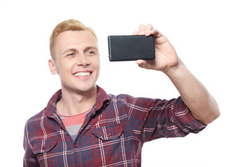 Young smiling man taking picture