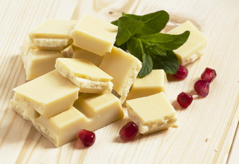 White chocolate with pomegranate seeds, selective focus